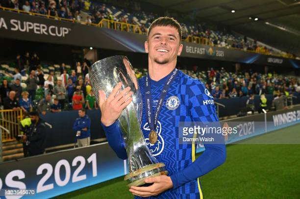Mason Mount of Chelsea poses for a photo with the UEFA Super Cup Trophy following victory in the UEFA Super Cup 2021 match between Chelsea FC and...