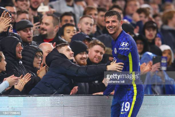 Mason Mount of Chelsea reacts with a fan in the crowd after missing a chance during the UEFA Champions League group H match between Chelsea FC and...