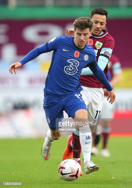 Mason Mount of Chelsea runs with the ball during the Premier League match between Burnley and Chelsea at Turf Moor on October 31 2020 in Burnley...
