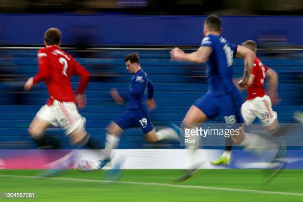Mason Mount of Chelsea runs with the ball during the Premier League match between Chelsea and Manchester United at Stamford Bridge on February 28,...