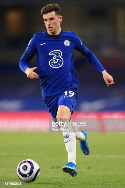 Mason Mount of Chelsea runs with the ball during the Premier League match between Chelsea and Arsenal at Stamford Bridge on May 12, 2021 in London,...