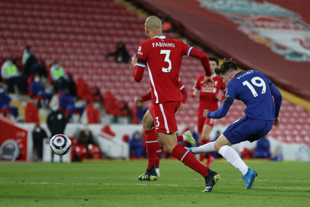 Mason Mount of Chelsea scores his side's first goal during the Premier League match between Liverpool and Chelsea at Anfield on March 04, 2021 in...