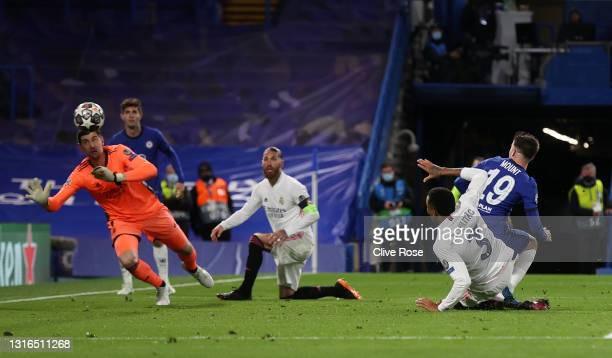 Mason Mount of Chelsea scores his team's second goal past Thibaut Courtois of Real Madrid during the UEFA Champions League Semi Final Second Leg...
