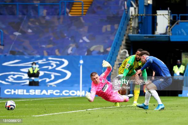 Mason Mount of Chelsea scores their team's second goal past Sam Johnstone of West Bromwich Albion during the Premier League match between Chelsea and...