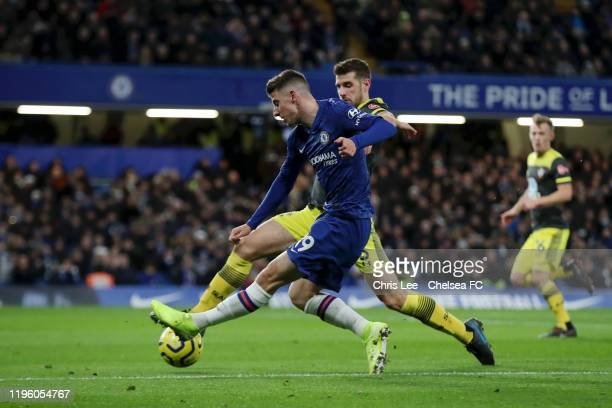 Mason Mount of Chelsea shoots during the Premier League match between Chelsea FC and Southampton FC at Stamford Bridge on December 26 2019 in London...