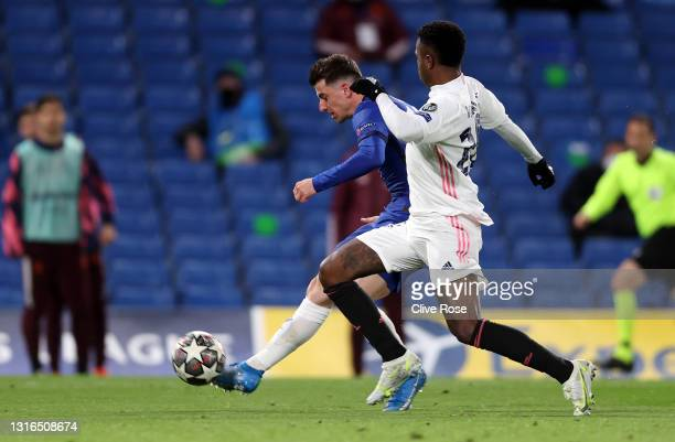 Mason Mount of Chelsea shoots under pressure from Vinicius Junior of Real Madrid during the UEFA Champions League Semi Final Second Leg match between...