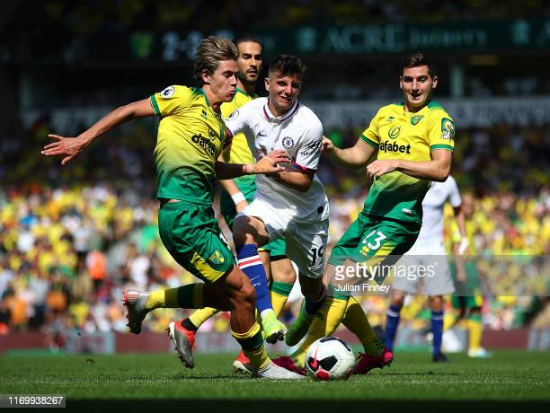 Mason Mount of Chelsea squeezes past Scott Cantwell and Kenny Mclean of Norwich during the Premier League match between Norwich City and Chelsea FC...