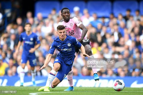 Mason Mount of Chelsea tackles Onyinye Wilfred Ndidi of Leicester City and goes on to score his team's first goal during the Premier League match...