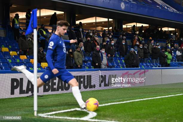 Mason Mount of Chelsea takes a corner kick as fans look on from the stands during the Premier League match between Chelsea and Leeds United at...
