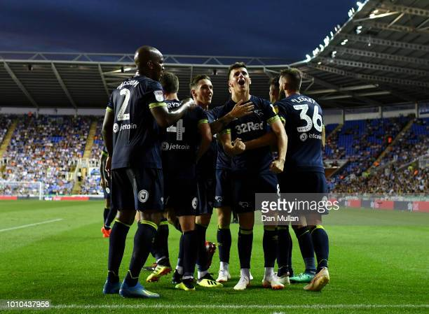 Mason Mount of Derby County celebrates with teammates after scoring his team's first goal during the Sky Bet Championship match between Reading and...