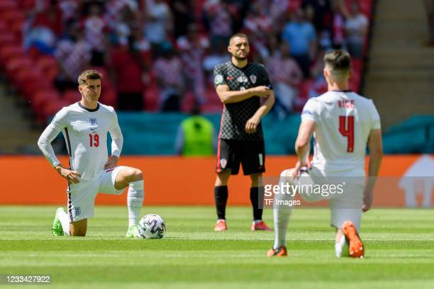 Mason Mount of England and Declan Rice of England knees down as a sign against racism during the UEFA Euro 2020 Championship Group D match between...