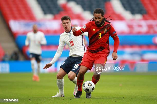 Mason Mount of England battles for possession with Jason Denayer of Belgium during the UEFA Nations League group stage match between England and...