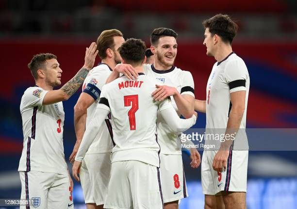 Mason Mount of England celebrates with Declan Rice, Harry Kane and Harry Maguire after scoring their team's second goal during the UEFA Nations...