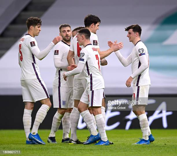Mason Mount of England celebrates with team mates John Stones, Luke Shaw, Harry Maguire and Phil Foden after scoring their side's second goal during...