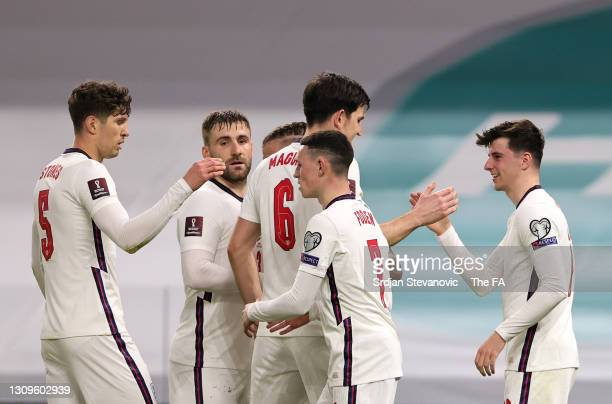 Mason Mount of England celebrates with teammates after scoring their team's second goal during the FIFA World Cup 2022 Qatar qualifying match between...
