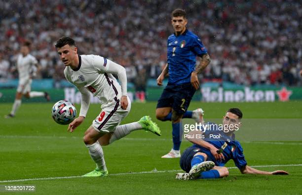 Mason Mount of England evades the tackle of Jorginho of Italy during the UEFA Euro 2020 Championship Final between Italy and England at Wembley...
