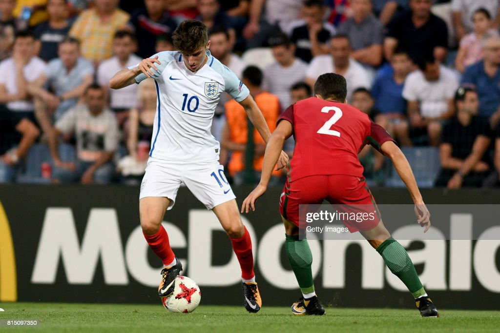 Mason Mount of England in action with Diogo Dalot of Portugal during the UEFA European Under-19 Championship Final between England and Portugal on July 15, 2017 in Gori, Georgia.