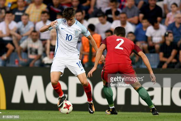 Mason Mount of England in action with Diogo Dalot of Portugal during the UEFA European Under19 Championship Final between England and Portugal on...