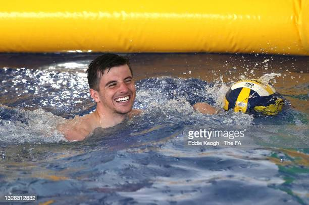 Mason Mount of England reacts during a game of volley ball in the swimming pool at St George's Park on June 30, 2021 in Burton upon Trent, England.