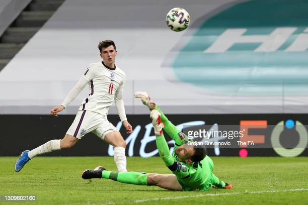 Mason Mount of England scores their side's second goal past Etrit Berisha of Albania during the FIFA World Cup 2022 Qatar qualifying match between...
