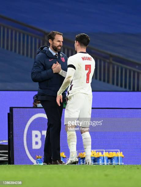 Mason Mount of England speaks with Gareth Southgate, Manager of England as he leaves the pitch during the UEFA Nations League group stage match...