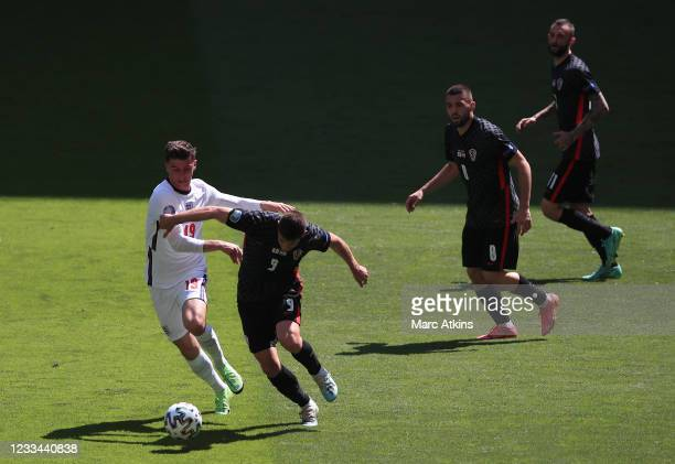 Mason Mount of England tangles with Andrej Kramaric of Croatia as Mateo Kovacic and Marcelo Brozovic look on during the UEFA Euro 2020 Championship...