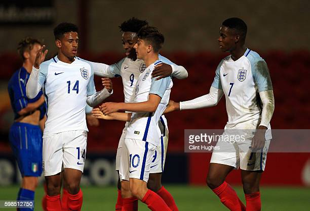 Mason Mount of England U18 celebrates with his teammates after he scores his sides second goal during the international friendly match between...