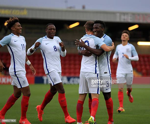 Mason Mount of England U18 celebrates with teammate Tolaji Bola after he scores his sides first goal of the game during the international friendly...