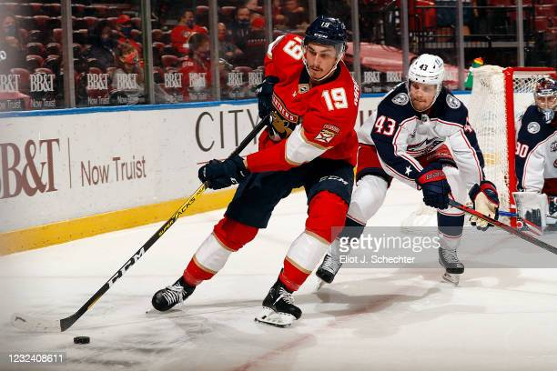 Mason Parchment of the Florida Panthers skates for possession against Mikko Lehtonen of the Columbus Blue Jackets at the BB&T Center on April 19,...