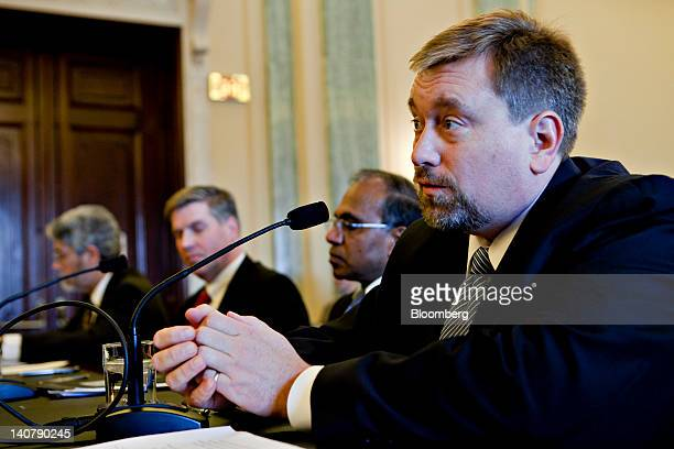 Mason Peck, chief technologist with the National Aeronautics and Space Administration , right, speaks at a Senate Commerce hearing with Subra Suresh,...