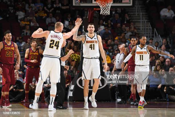 Mason Plumlee and Juan Hernangomez of the Denver Nuggets exchange a high five during the game against the Cleveland Cavaliers on November 1 2018 at...