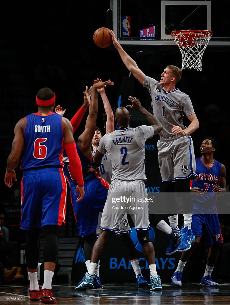 Mason Plumlee (2nd R) and Kevin Garnett (C) of Brooklyn Nets in action against Brandon Jennings (R) and Josh Smith (L) of Detroit Pistons during NBA basketball game between Brooklyn Nets and Detroit Pistons at the Barclays Center in the Brooklyn Borough of New York City, on December 21, 2014.