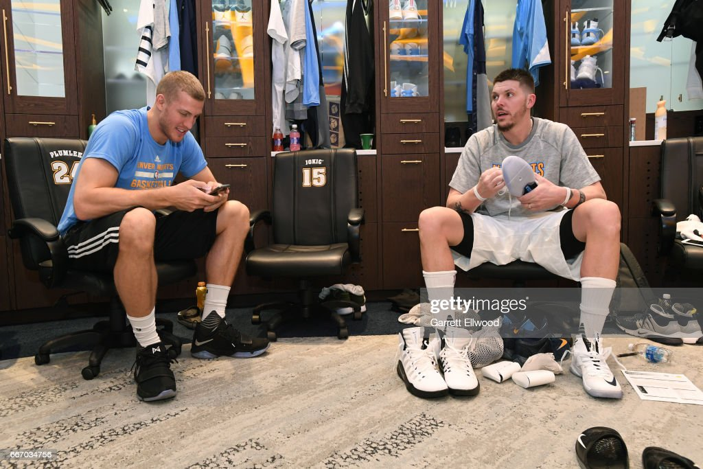 Mason Plumlee #24 and Mike Miller #3 of the Denver Nuggets get ready in the locker room before the game against the Los Angeles Lakers on March 13, 2017 at the Pepsi Center in Denver, Colorado.