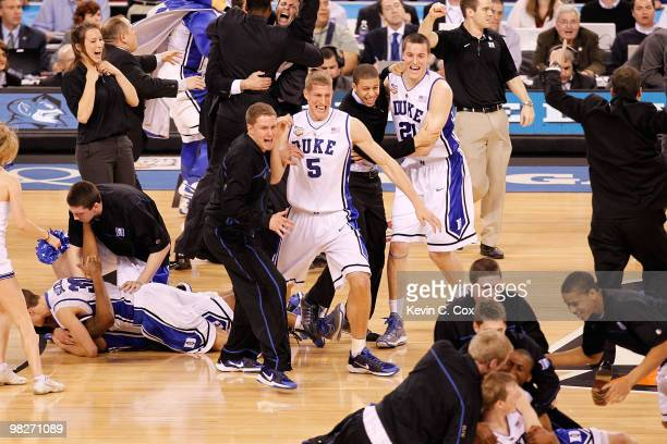 Mason Plumlee and Miles Plumlee of the Duke Blue Devils celebrate after the Blue Devils defeat the Butler Bulldogs 6159 in the 2010 NCAA Division I...
