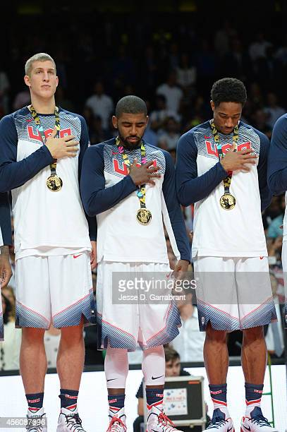 Mason Plumlee, Kyrie Irving and DeMar DeRozan of the USA Men's National Team stands for the National Anthem after defeating the Serbia National Team...