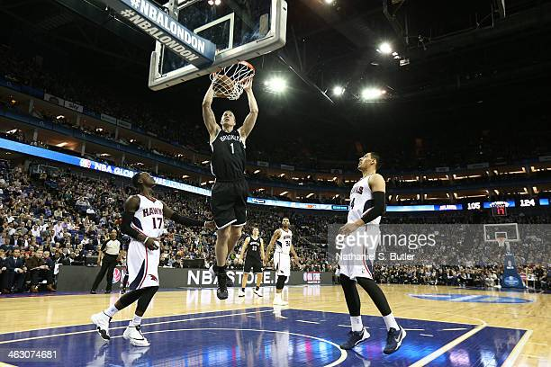 Mason Plumlee of the Brooklyn Nets dunks against the Atlanta Hawks as part of the 2014 Global Games on January 16 2014 at The O2 Arena in London...