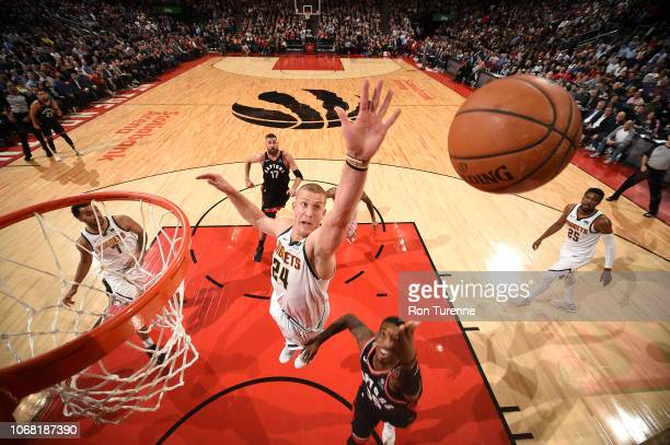 Mason Plumlee of the Denver Nuggets blocks against Delon Wright of the Toronto Raptors on December 3 2018 at the Scotiabank Arena in Toronto Ontario...