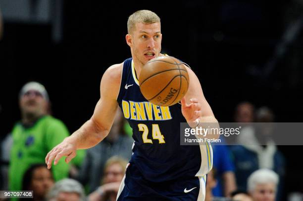 Mason Plumlee of the Denver Nuggets dribbles the ball against the Minnesota Timberwolves during the game on April 11 2018 at the Target Center in...