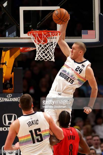 Mason Plumlee of the Denver Nuggets dunks against AlFarouq Aminu of the Portland Trail Blazers in the third quarter at the Pepsi Center on January 13...