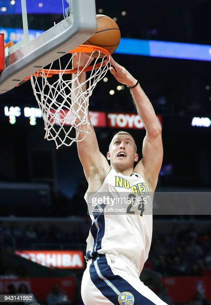 Mason Plumlee of the Denver Nuggets dunks the ball during the second half of the game against the Los Angeles Clippers at Staples Center on April 7...
