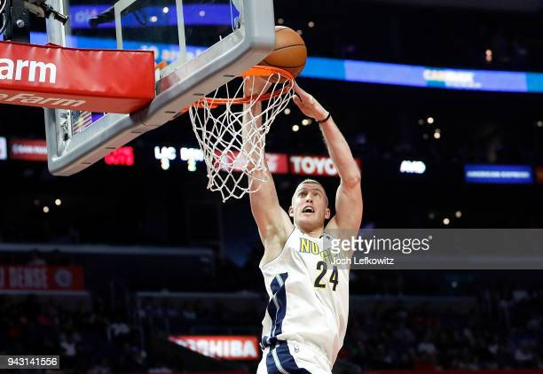 Mason Plumlee of the Denver Nuggets dunks the ball during the second half of the game against the Los Angeles Clippers during the game at the Staples...