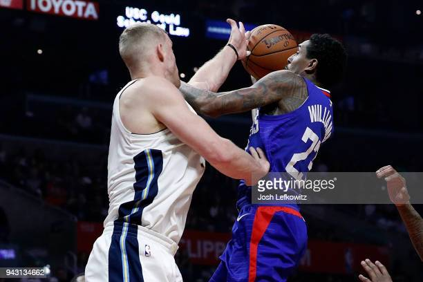 Mason Plumlee of the Denver Nuggets fouls Lou Williams of the Los Angeles Clippers during the first half of the game at Staples Center on April 7...