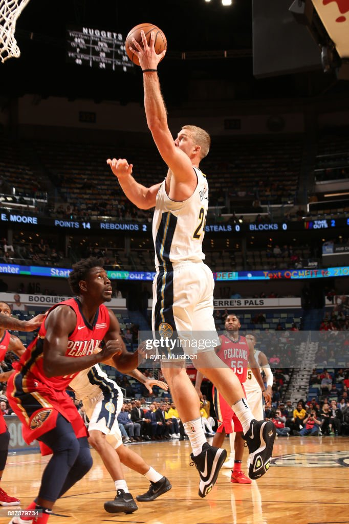 Mason Plumlee #24 of the Denver Nuggets goes to the basket against the New Orleans Pelicans on December 6, 2017 at Smoothie King Center in New Orleans, Louisiana.