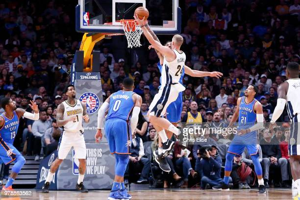 Mason Plumlee of the Denver Nuggets goes to the basket against the Oklahoma City Thunder on November 9 2017 at Pepsi Center in Denver Colorado NOTE...