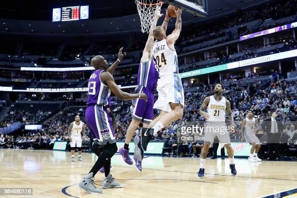 Mason Plumlee of the Denver Nuggets goes to the basket against the Sacramento Kings on March 6 2017 at the Pepsi Center in Denver Colorado NOTE TO...