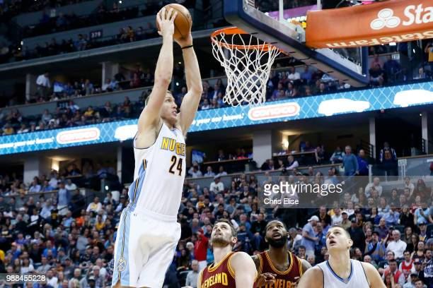 Mason Plumlee of the Denver Nuggets goes up for a dunk against the Cleveland Cavaliers on March 22 2017 at the Pepsi Center in Denver Colorado NOTE...