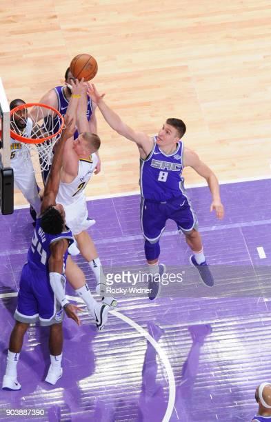 Mason Plumlee of the Denver Nuggets goes up for the shot against Bogdan Bogdanovic of the Sacramento Kings on January 6 2018 at Golden 1 Center in...