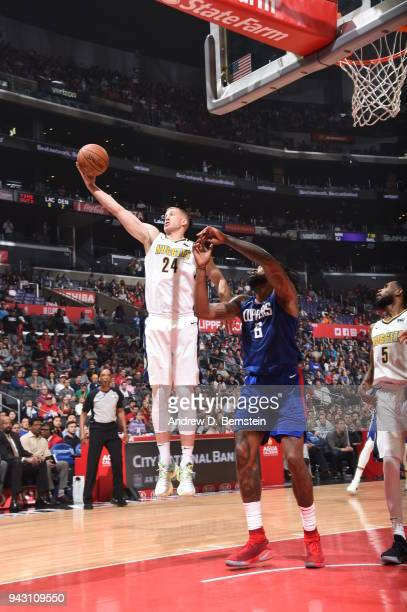 Mason Plumlee of the Denver Nuggets grabs the rebound against the LA Clippers on April 7 2018 at STAPLES Center in Los Angeles California NOTE TO...