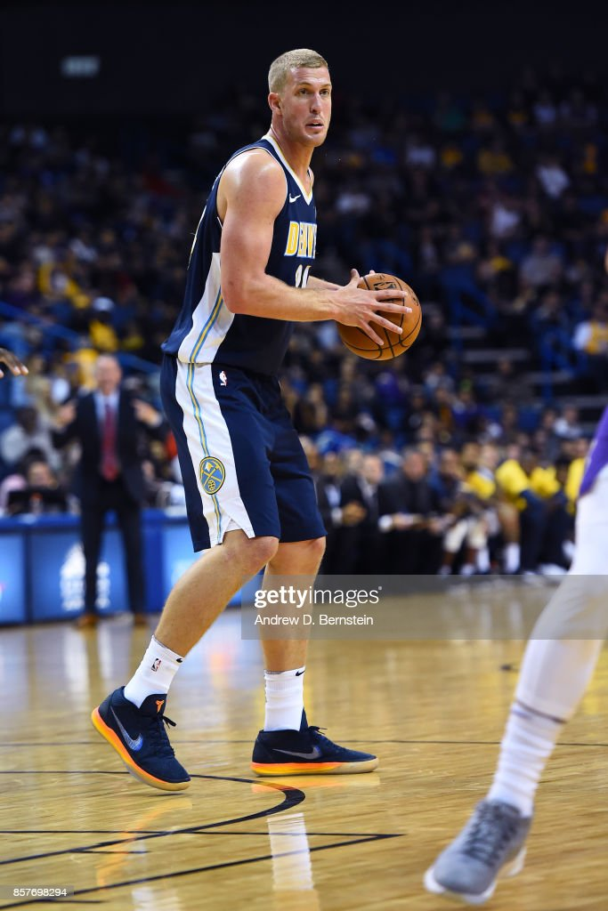 Mason Plumlee #24 of the Denver Nuggets handles the ball against the Los Angeles Lakers on October 4, 2017 at Citizens Business Bank Arena in Los Angeles, California.