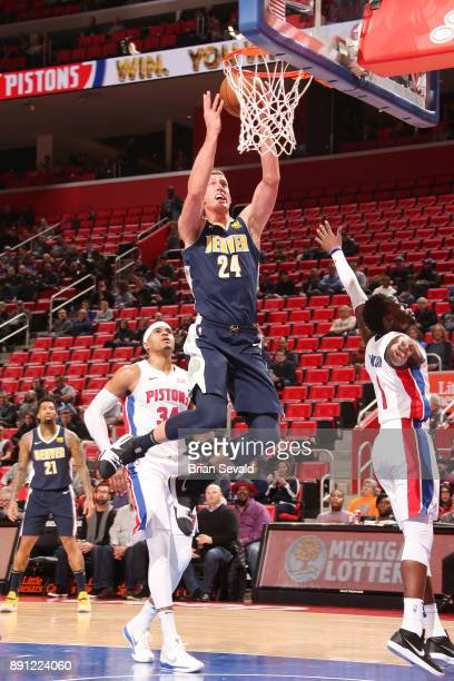 Mason Plumlee of the Denver Nuggets handles the ball against the Detroit Pistons on December 12 2017 at Little Caesars Arena in Detroit Michigan NOTE...